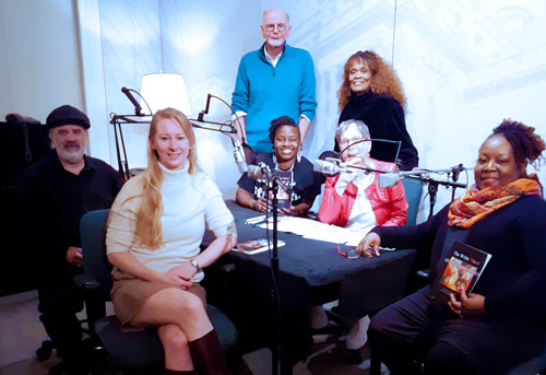Picture of The Write Blend Poets on-air, L to R: Clifford Bernier, Liz Reitzig, Diane Wilbon Parks, (Grace Cavalieri,) Miss <ETH>Kiane� Thomas. Standing: Dr. Hiram Larew and Billye O?Kera.